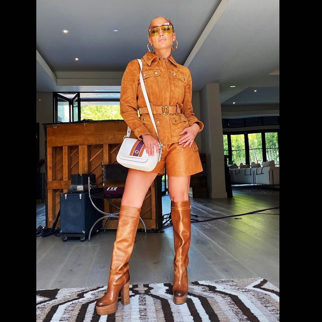 Jennifer Lopez Wearing Leather Jacket And Matching Shortswhat Stars Own What Stars Own
